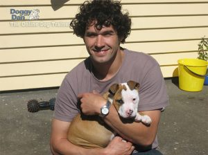 Doggie Dan with a pit bull puppy.